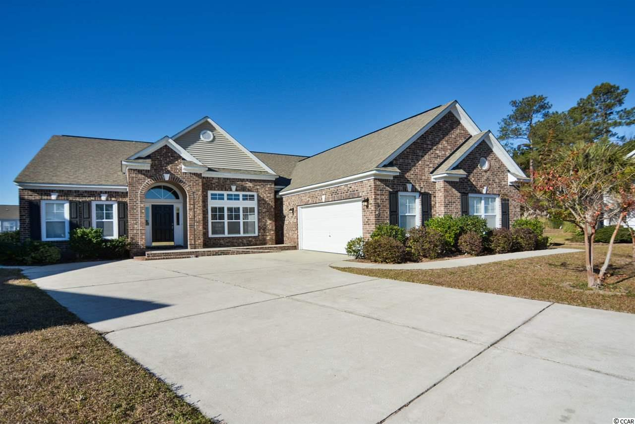 4bd/2.5ba single-story home on the lake in the highly desirable Berkshire Forest just 5 miles to the beach! Owners in this neighborhood also have full access to the amenties of Atlantica, an oceanfront resort located in the heart of Myrtle Beach. This handi-cap accessible spacious home has a split floor plan with ALL 4 bedrooms on the 1st floor! 2 of those beds over-look the large lake as well as the living room, kitchen, and Carolina room. ALL NEW carpet in all bedrooms and beautiful hardwood floor throughout the rest of the home. Use the endless amounts of storage space as a 2nd pantry or extra storage. BRAND NEW HVAC in 2013! Enjoy everything the amenity center has to offer including the HUGE pool, lounges, tennis courts, basketball courts, playground, picnic pavilions, dock and boat launch into large private lake.  Perfect for a small boat, canoe, kayak or paddleboat! Berkshire Forest is just a few minutes drive to everything Myrtle Beach has to offer including Coastal Grande Mall, Tanger Outlets, marinas, public docks, landings, restaurants, golf courses, shops, entertainment, Myrtle Beach International Airport, Broadway At The Beach, The Market Common, Barefoot Resort and Coastal Carolina Univeristy (CCU).