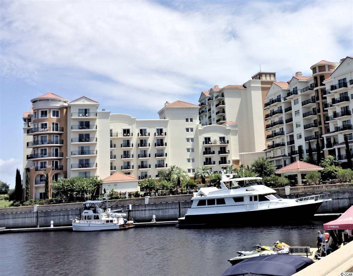 2 Br/2 Ba At The Elegant Grande Dunes Marina Inn. Luxury At It's Finest! This Property Is A Front, Corner, End Unit; Great For Privacy! Breathtaking Views Of The ICW And Grande Dunes Championship Resort Golf Course From Both Oversized Terraces. Watch The Yachts Float By From Your Master Bedroom, Living Room, Dining Room And Even While Preparing A Meal In The Designer Kitchen. The Prestigious Grande Dunes Marina Inn Has Been Awarded 4 Diamonds By AAA Which Makes This A One Of A Kind Property. Valet/Concierge Is Available 24Hrs A Day. Have Breakfast By The Pool or Enjoy Wonderful Dining On Property At Waterscapes Restaurant And The Reflections Lounge. Ruth's Chris And The Anchor Cafe Is Just Steps Away. The Resort Style Pool Deck Overlooks The 126 Slip Full Service Marina. Fitness Center, Sauna and Indoor Pool are right inside. Indulge Yourself With Year-Round Activities; Golf, Boating, Tennis, Biking and The Beach. A Beach Shuttle Is Available To Take You To And From The Beach Cabana Where Your Chairs & Umbrellas Will Be Set Up For You. Best Of All, Only Property Owners Are Granted Exclusive Membership(all Privledges) At The Oceanfront OCEAN CLUB!