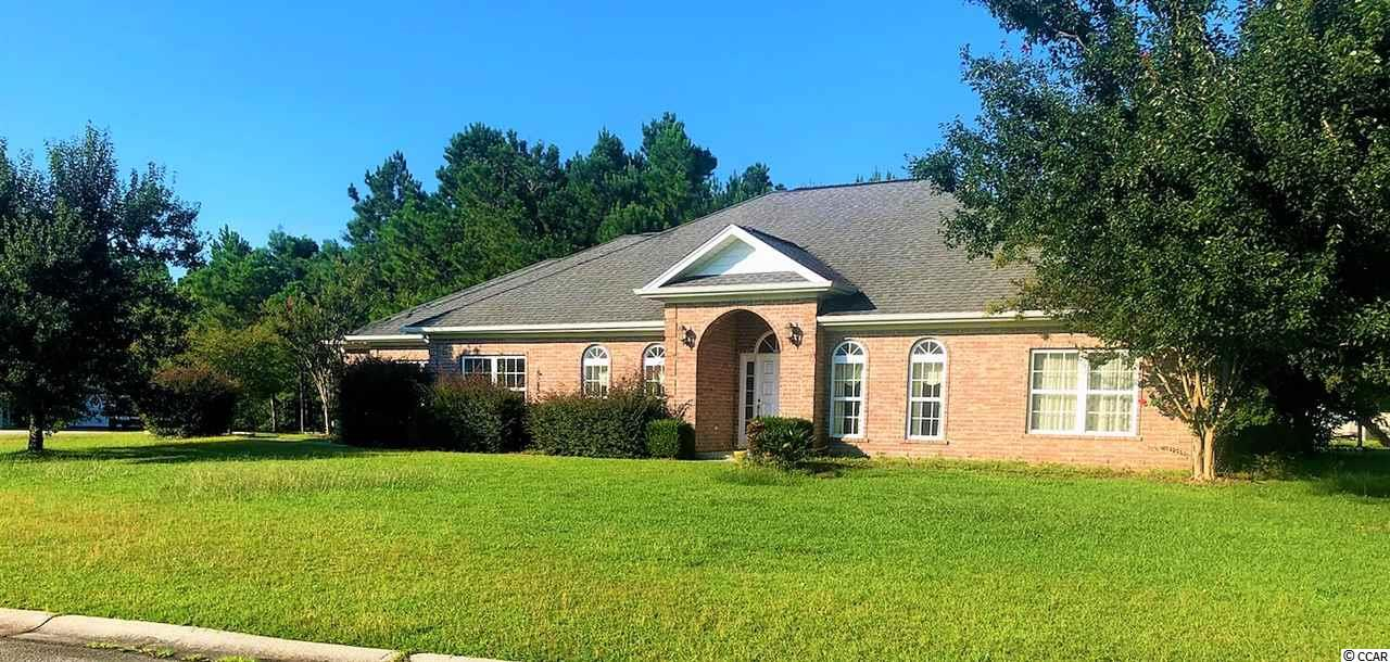 3bd/3ba Single Level ALL BRICK home on HUGE 1/2 Acre Corner Lot only 5 miles to the beach!Very easy access from the parking area as the house has NO STEPS.  Separate Dining Room AND Separate Office. Each bedroom has its own bathroom. Enjoy the heated bonus room off the 2-car garage which is perfect for an office, or true htd storage. Large yard space is great for hosting family get-togethers. Charming brick side patio right off the kitchen is perfect for grilling. This home boasts beautiful hardwood floors, tray ceilings, and a large fireplace in the living room. The Hunters Ridge HOA allows pets (including dogs & cats)! Hunters Ridge is just a few minutes drive to everything Myrtle Beach has to offer including Coastal Grande Mall, Tanger Outlets, marinas, public docks, landings, restaurants, golf courses, shops, entertainment, Myrtle Beach International Airport, Broadway At The Beach, The Market Common, Barefoot Resort and Coastal Carolina Univeristy (CCU).