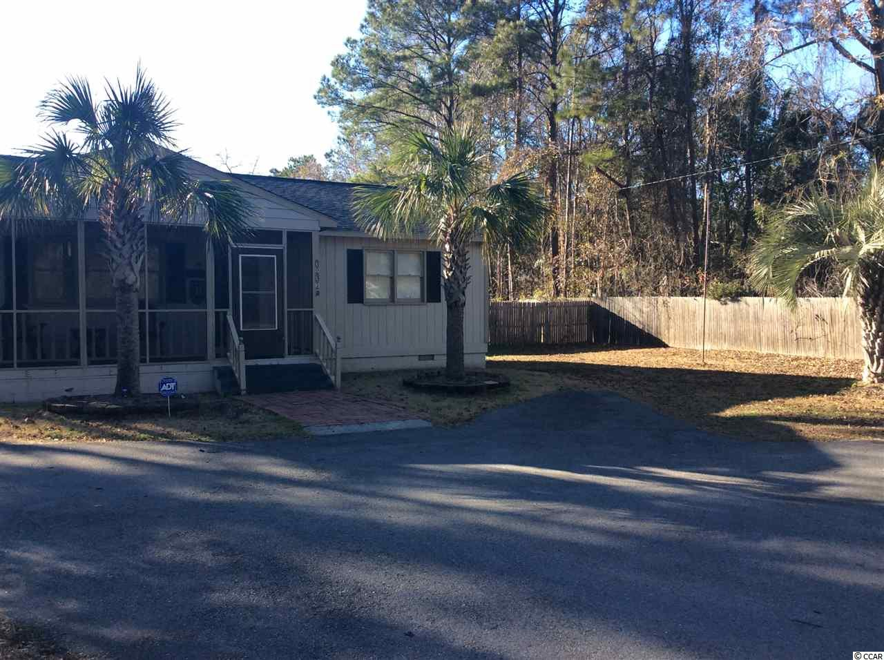Small home with lots of land in the middle of Pawleys Island. Screen Porch. Room for a pool and outdoor patio living area. Carport/shelter and lots of parking for your vehicles. Detached workshop or living area with 1/2 bath. Per tax records over 1 acre.