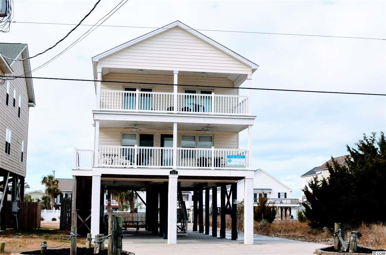 Beautiful beach house with ocean views from both balconies, living room, dining room and 2 bedrooms! Very well maintained. Flat screen TV's in every bedroom and living room. Room to spread out, two large balconies. Outdoor shower, Pool, hot tub, lots of parking space.  Across the street from the ocean, short walk to the Garden City Beach pier, arcades, restaurants and more! Popular vacation rental area.