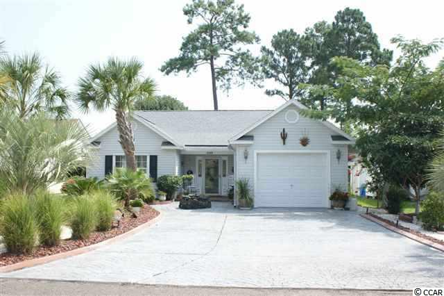 One of the largest homes in Myrtle Beach Golf and Yacht. Tile, hardwood flooring, Carolina room, screened porch, gameroom, enclosed covered hottub room and covered patio. Lush landscaping encompasses this home. Newer  roof, hurricane protection for exterior windows, newer hot water heater. Remote controlled skylight in master bath. Hardwired security and fire alarm, covered patio. Community offers 24 hour security, tennis, pool, clubhouse, weightroom, storage area for boats/trailer. Less than one mile to Intra Coastal public boat landing. Price is firm.