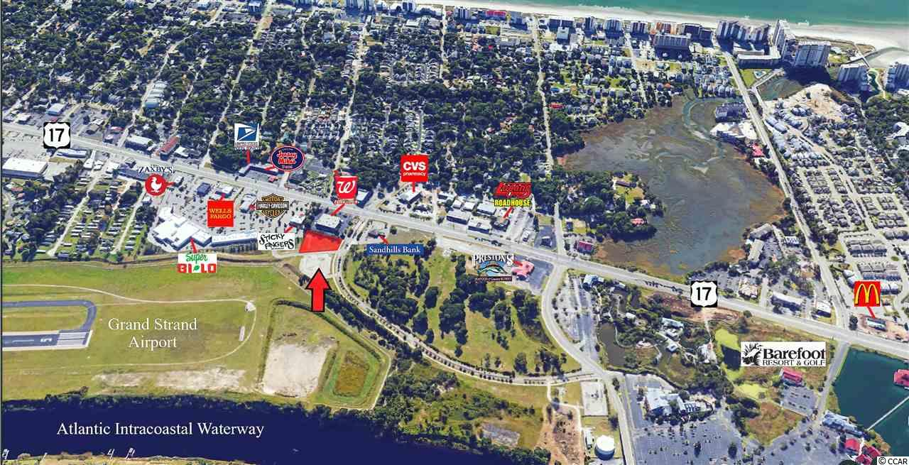 US HWY 17 Lot and Windy Hill Drive with 86 ft of road frontage at entrance of Barefoot Resort and Golf and Barefoot Commons next to Walgreens! Over 46,000 cars pass this lot daily! Build to suit with long term lease!