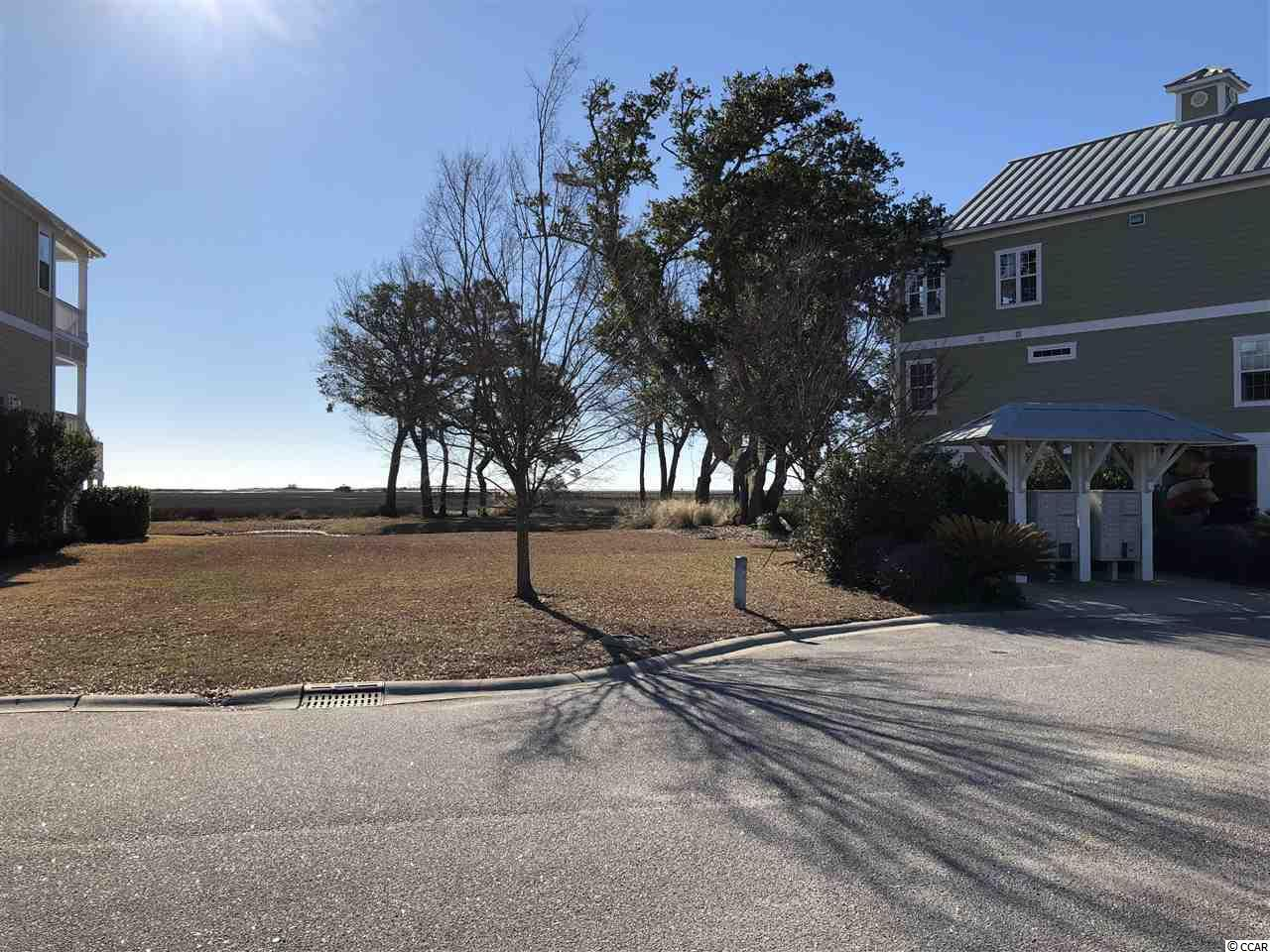 Bring your dream home plans and build on this beautiful marsh front lot in the prestigious Enclave Community in Pawley's Island. Nice flat lot with gorgeous views ready for your dream home build. Very few marsh front lots left in the area. Enjoy the best the low country has to offer with views galore, private dock, club house and pool located in a quaint gated community in the heart of Pawley's Island. Near shopping, beaches, wonderful restaurants and all the other amenities Pawley's Island has to offer. This lot won't last long!