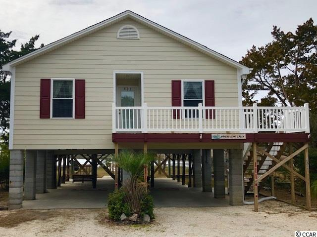 """If you enjoy fishing, crabbing, or kayaking, this """"arrogantly shabby"""" raised beach home is waiting for you. This 4BR/2BA home takes you back to yesteryears: a time when life was slow, the sun was bright, and breezes were cool and and refreshing. Come enjoy all the best that the lowcountry beaches of Pawleys Island has to offer. Take your boat that awaits at your dock for an afternoon cruise up the creek with wine glass in hand while observing the gray herons, pelicans, and other fowl that live in the water. You may also want to drop a line to catch flounder or just watch the grandkids fish for anything that will bite. Make no mistake, a lifetime of memories will be made. Be sure to put this home on your list to see. You will not be disappointed. HOME EXTERIOR JUST PAINTED 2/23/19. We have attempted to provide accurate information but we do not guarantee the accuracy of any statement regarding, but not limited to: square feet, zoning, restrictions, utilities, and property components age or condition. Buyers and/or their agents are responsible to verify any and all information."""