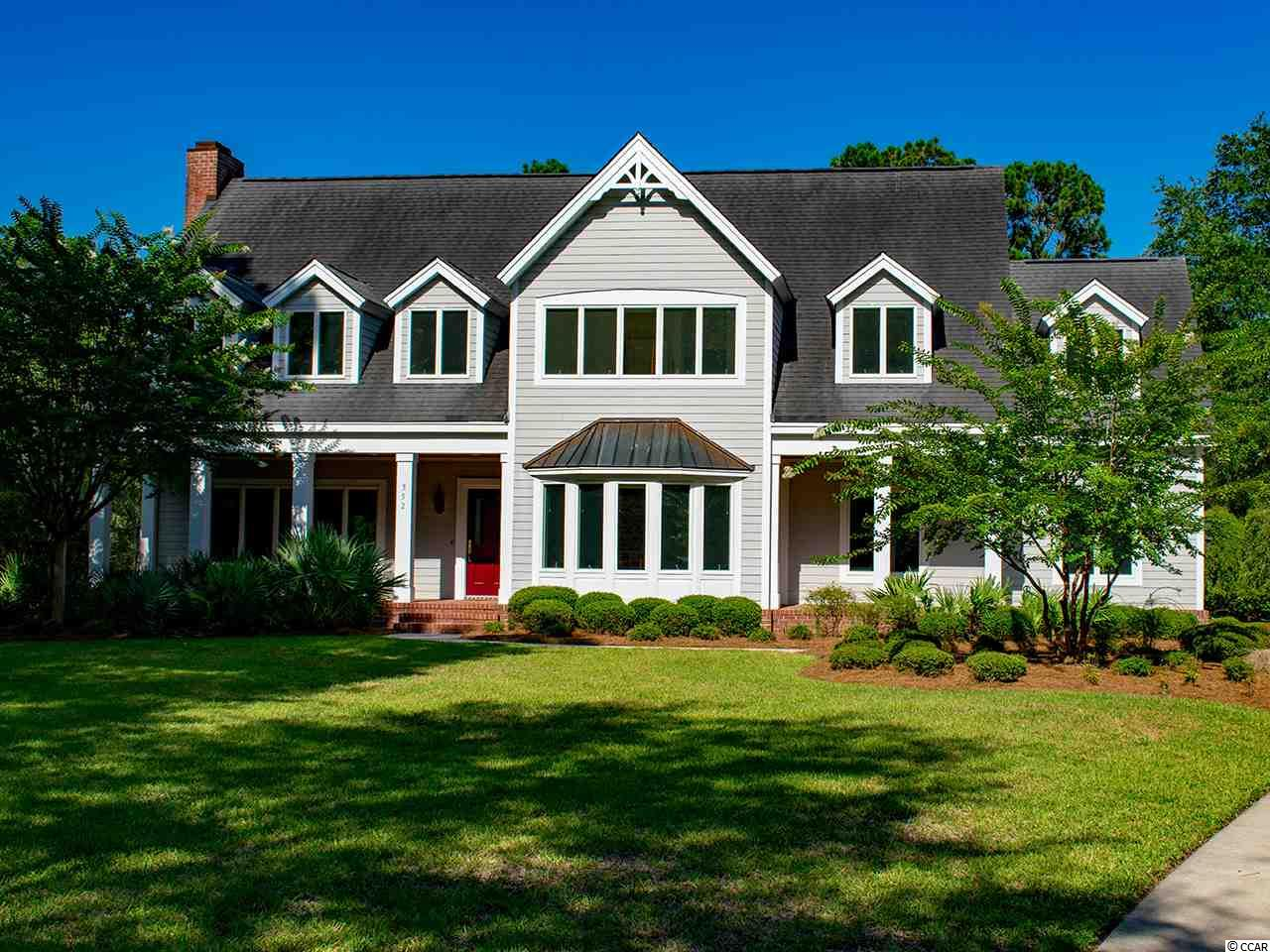 This is your chance for the peaceful, private retreat you've been looking for with over 220 ft. of lake frontage in the large back yard! Set on a full acre on DeBordieu's coveted Old Carriage Loop, this traditional home is solid and move in ready. Features on the first floor include a wood burning fireplace and built in shelves in a living room that opens up to a fabulous screened porch as well as a formal dining room with intricate dental crown and chair rail moldings. The kitchen is right off of the dining room and includes a work island, thermador oven and cozy breakfast nook. Upstairs is the oversized Master Suite with a generous walk in closet and large bathroom with whirlpool tub. Down the hall from the Master you will find two other guest rooms, each with an en suite bathroom, as well as an office and bonus room. The two car garage has plenty of room for storage. DeBordieu is a private, oceanfront, gated community with miles of beach, easy access to the North Inlet and Atlantic Ocean, a famous 18 hole Pete Dye designed golf course, dining, pools, tennis and much, much more.