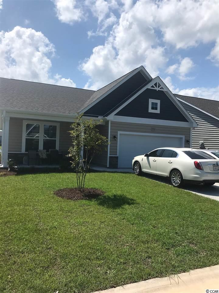 This brand new Harmony plan very functional in one level living. It offers flexibility of a 3 bed 2 bath with study or formal dining room, but can always serve as a 4 bed 2 bath home. Come in through the large open foyer and to one side you have bedroom bathroom and to the other you have optional mudroom walking in to the laundry room plus another bedroom. Lots of neat structural options offered like access door from master closet to bedroom 3 or directly to laundry room. 2 Bay Window options, 3 master bath options, Fireplace Option, Gourmet Kitchen option, 3 Exterior Design Options. The spacious Kitchen opens to the great room with large Island Bar with overhang for seating. Off the kitchen is Casual Dining Room to the back of the home. Huge Master Walk-in Closet. All of this plus Front Porch & nice sized rear Covered Porch offering privacy directly in the middle of home. As a Brookberry resident you have full access to The Farms 2 resort-style pools, clubhouse, fitness center, basketball court, and a playground. All this plus access to the Atlantica beach club. The Most convenient Location Central to all the Grand Strand in the Award Winning School District of Carolina Forest. Only a few Homesites Remaining in this very welcoming neighborhood. Pictures Represent Same Home Plan built with upgrades.