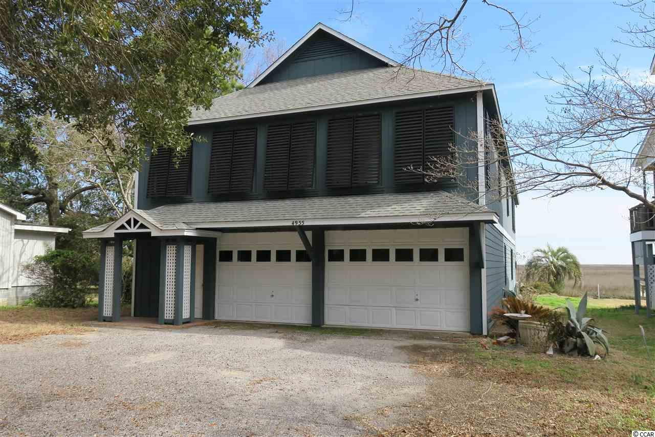 Great Creek front home with panoramic views of the Murrells Inlet Marsh front and jetties leading to the beautiful Atlantic Ocean. You'll enjoy your morning cup of coffee on the front deck watching the sun rise and your evening beverage of choice sitting on the dock watching the tide roll in. Stationary and floating dock for your creek boat enjoyment. Endless summer breezes await you from your unobstructed views across the Marsh to the Atlantic with the sound of the waves delivered directly to your balcony. Spacious living room with vaulted ceiling and gas fireplace. True hardwood floors throughout main living area and bedrooms. The kitchen has a down draft stove top situated on an island overlooking the living area and the marsh view. Endless hot water awaits you with a gas, tank-less water heater. This home boast endless possibilities starting with additional living space. The whole ground level is walled in, wired and insulated. This could easily be heated and cooled adding additional bedrooms or converted into an Apartment / Mother in law suite. An extra bedroom could be added to the main living area with the addition of a ten foot wall. Outside was recently painted with three coats of paint along with replacement of front steps and decking boards. Stationary and floating docks have been replaced since hurricane Matthew. The owners built this home to last with four foot deep outside footers encapsulating the 6x6 pillars, re-enforced with re-bar. The home is as solid as you'll find with absolutely no sway as you'll find in some raised beach homes. Three well established Creek Front Restaurants just a short stroll down the street. The picturesque Murrells Inlet, Pawleys Island bike path runs directly behind the home. Please put this home on top of your search list and ask your agent or call me today for a personal showing. Owner will consider a lease purchase / owner financing scenario.