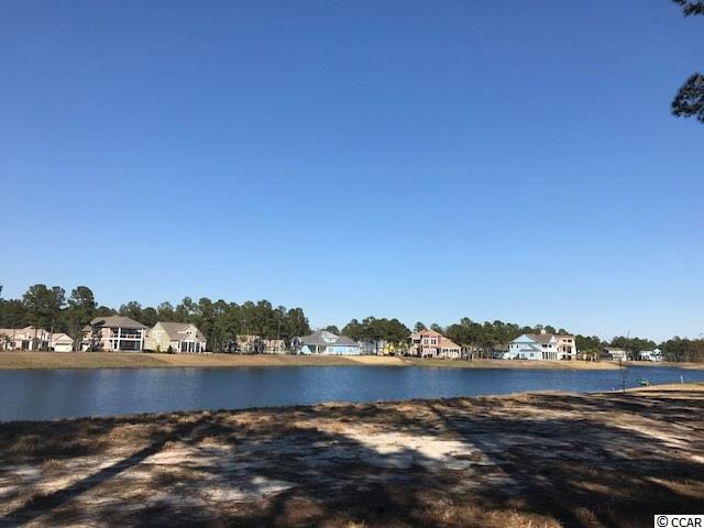 Beautiful lake front lot in the gated community of Waterbridge. This lot gives  long views of the lake with an easy walk to the amenities center. Amenities include an amazing pool area, fitness center, walk down fire pit, swim up refreshment bar, tennis courts, volleyball and basketball courts,  boat ramp and pier. Located in the heart of Carolina Forest. Great Price Improvement!
