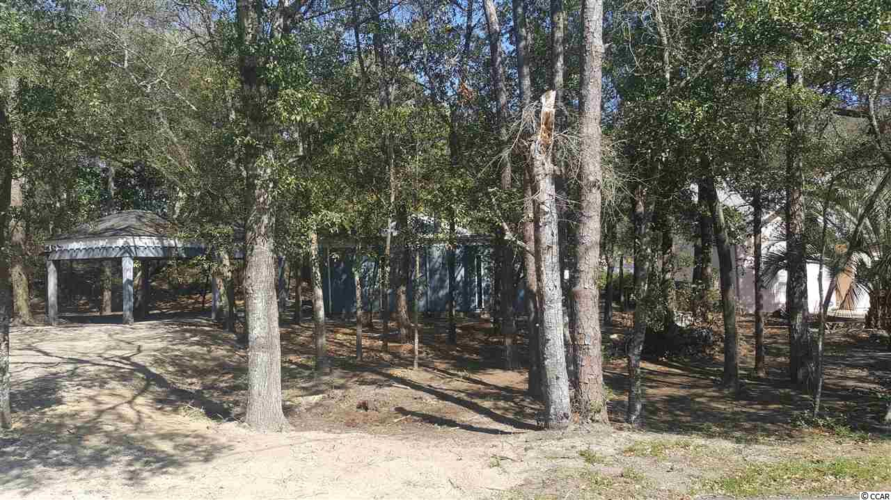 3BR / 2BA cottage with character 3 short blocks to the beach on beautiful large (75 x 143) wooded lot.