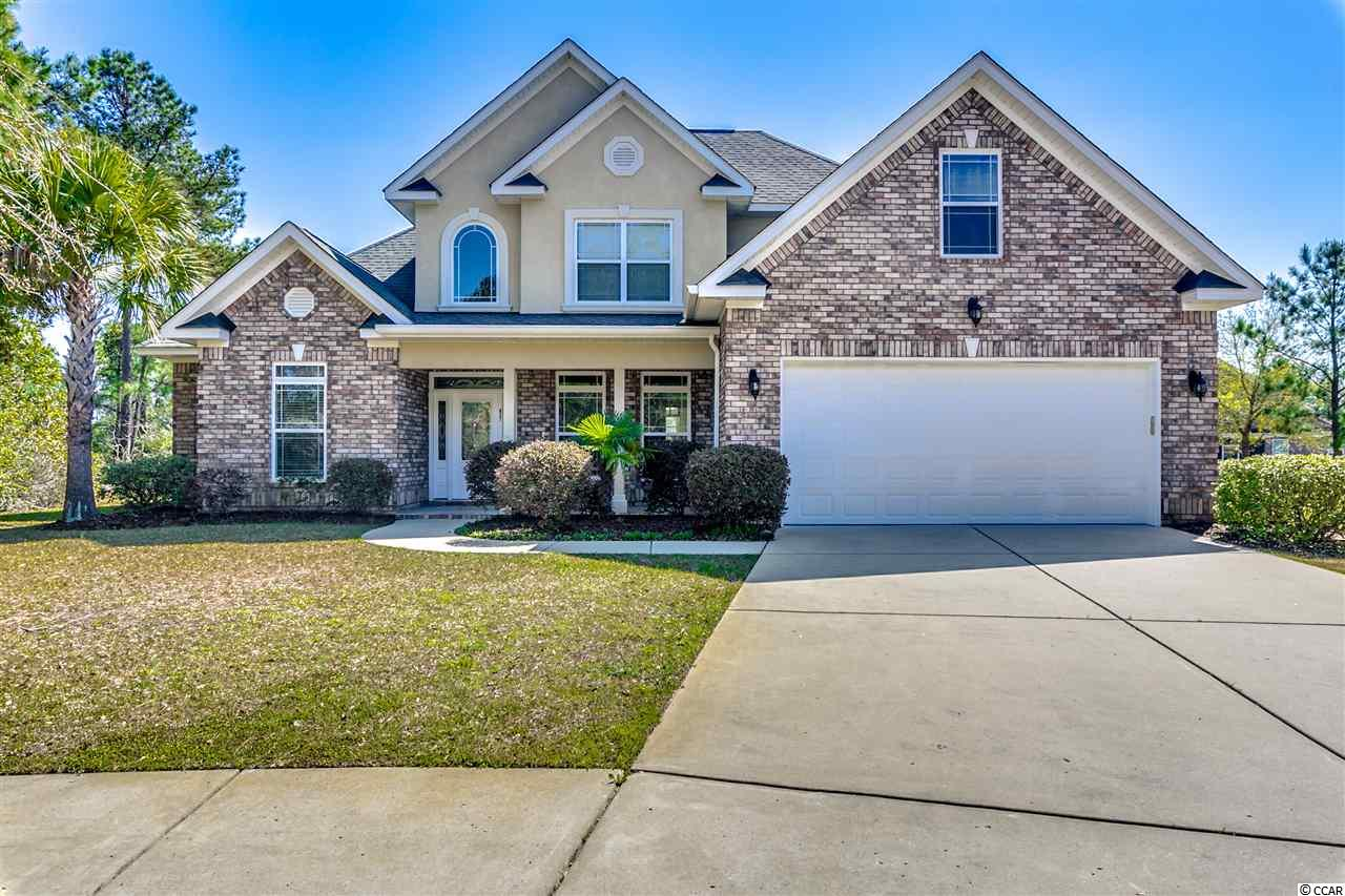 Welcome to this all brick home on an extra large .31 acre pie shaped lot in a cul-de-sac on the lake!  You'll appreciate the granite counters in the fully-equipped kitchen with stainless appliances and refrigerator.  A Carolina Room with skylights and vaulted ceiling overlook the tranquil back yard and pond.  The Master bedroom is located on the main level with on-suite bath which includes a spa tub and separate tiled shower.  Two additional bedrooms and a spacious bonus room are located on the 2nd floor along with another full bath.  All baths feature granite counters at comfort height.  Covington Lakes is an upscale gated community with all brick or stucco homes, miles of connected lakes and a community pool.