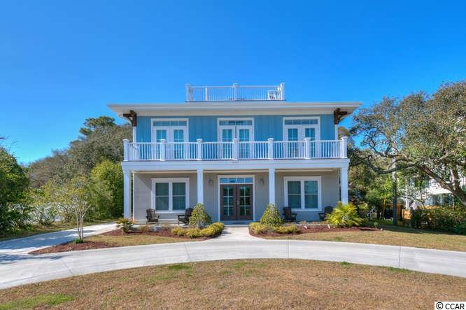 Coastal Living with Ocean Views on the Golden Mile. This Low Country Charmer offers 4 bedrooms 3.5 Baths and is 2 years young. Large Beautiful Protected Ocean Oak shades the screened in porch in your backyard which is made for entertaining. Your new homes has natural gas, all the bells and whistles, and is NOT in a flood zone that requires flood insurance.
