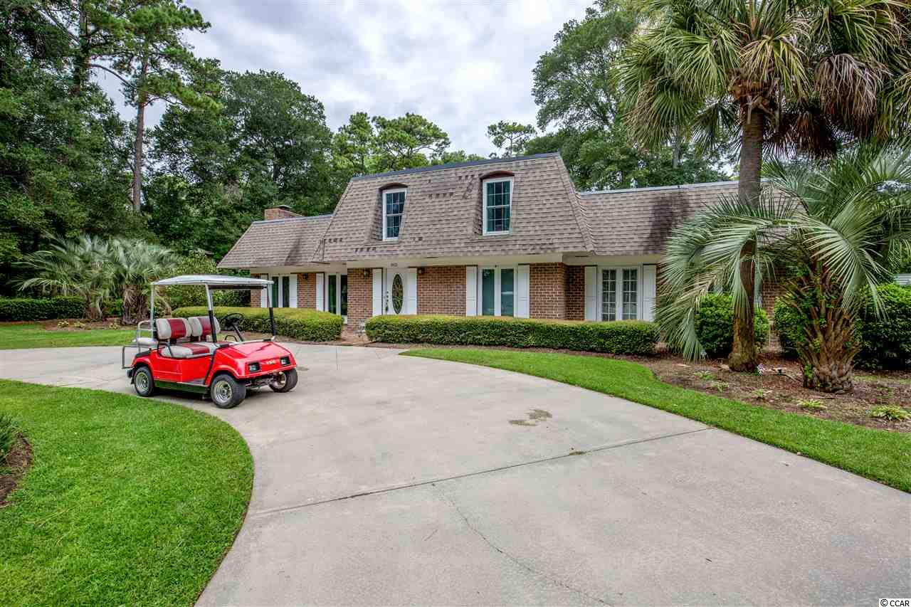 Location! Location! Location! Very Rare opportunity to purchase a very private Gated Estate Style Property only steps away from the beautiful Atlantic Ocean in one of Myrtle Beach's hidden and tucked away locations. Arcadian Shores is centrally located and convenient to everything the Grand Strand has to offer! This is Definitely Myrtle Beach's most pristine and private stretches of beach! The backyard features a private in-ground pool, a covered Lanai, Sun Decks, Pool House with bathroom, workshop, grilling area and mature landscaping designed where something is always in bloom every season!! The Private Beach Access is very convenient and unique. Location! Location! Location! Discounted Rates to Kingston Plantation featuring a world class Spa, Fitness Center, Indoor Pool, and first class Tennis Facility! Arcadian Shores Golf Club is a very short walk! You will love the large mature oaks and there is even a gorgeous Live Oak Tree on the front corner of the property next to the beautiful 7 Acre private Lake just across the street from the Private Beach Access! Brand New Roof, and new Hardwood Floors! Seller is Licensed Real Estate Agent Location! Location! Location!