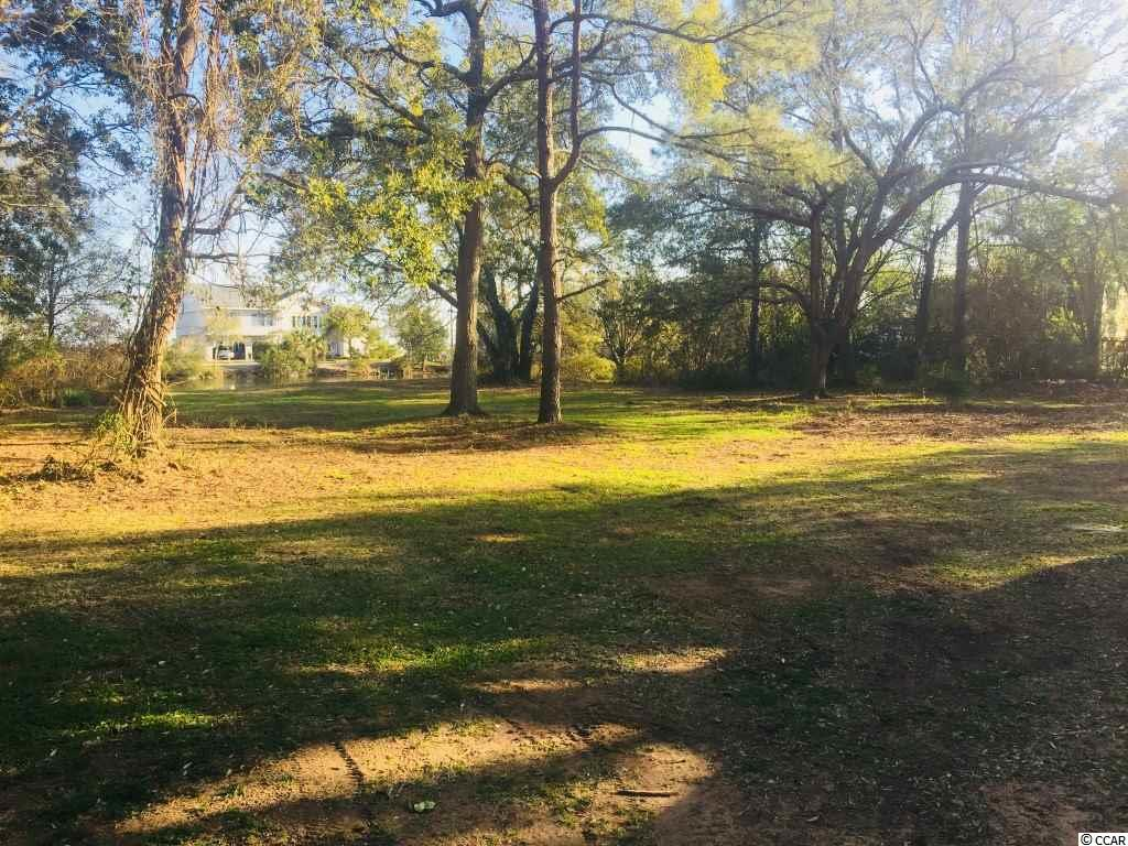 Beautiful lot, located in the heart of Murrells inlet just minutes away from the Marsh Walk and Public Boat Landing.  Owner is related to the Listing Agent.  Great views of the inlet from the property.