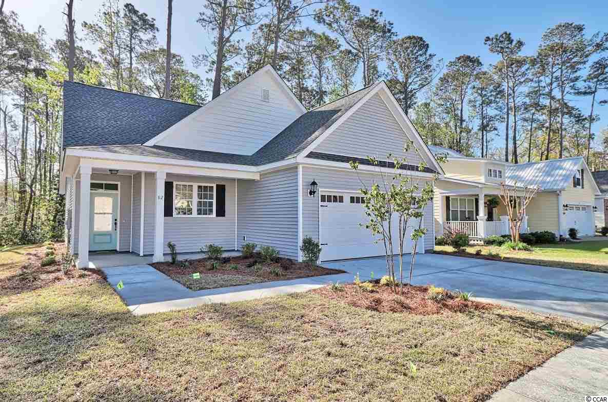 Beautiful home in Bridges of Litchfield. Master on the main floor, open living space, granite countertops, custom cabinetry, all the nice things you are looking for. Lot backs to private wetland area. Owner is SC Realtor.