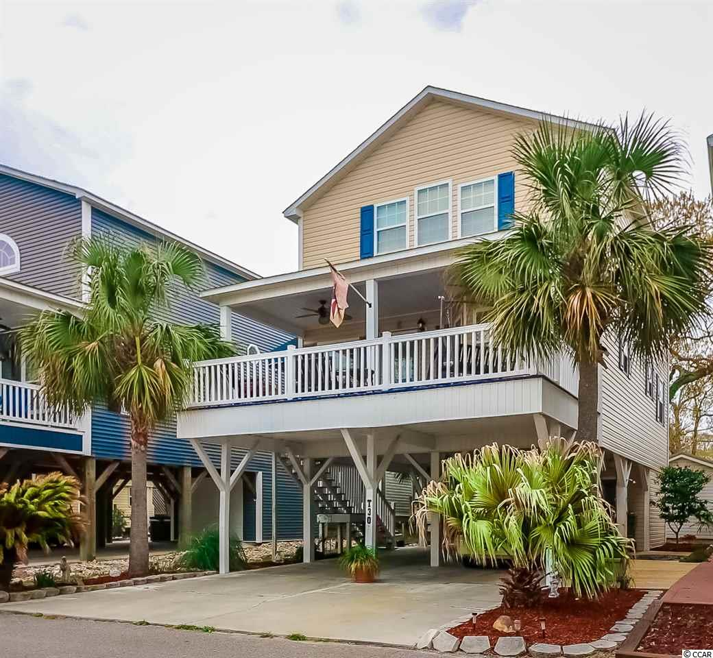 Check out this raised 4 bedroom beach home in the award winning Ocean Lakes Family Campground. This home comes fully furnished, so all you need to do is pack your bags! This property offers an open floorplan with a large kitchen island and dining area that is open to the living room. The home also offers updated laminate, extra closet space, lots of cabinets, and don't forget the large upstairs master bedroom! Enjoy the salty breeze while sitting out on the large deck. Just a short golf cart ride to the beach! This home is conveniently located close to all the amenities that comes along with Ocean Lakes Family Campground. Amenities included are indoor/outdoor pools, lazy river, waterpark, mini-golf, arcade, basketball courts, volleyball courts, and much more! Come check out this property today. ALL MEASUREMENTS ARE APPROXIMATE AND NOT GUARANTEED. BUYER IS RESPONSIBLE FOR VERIFICATION.