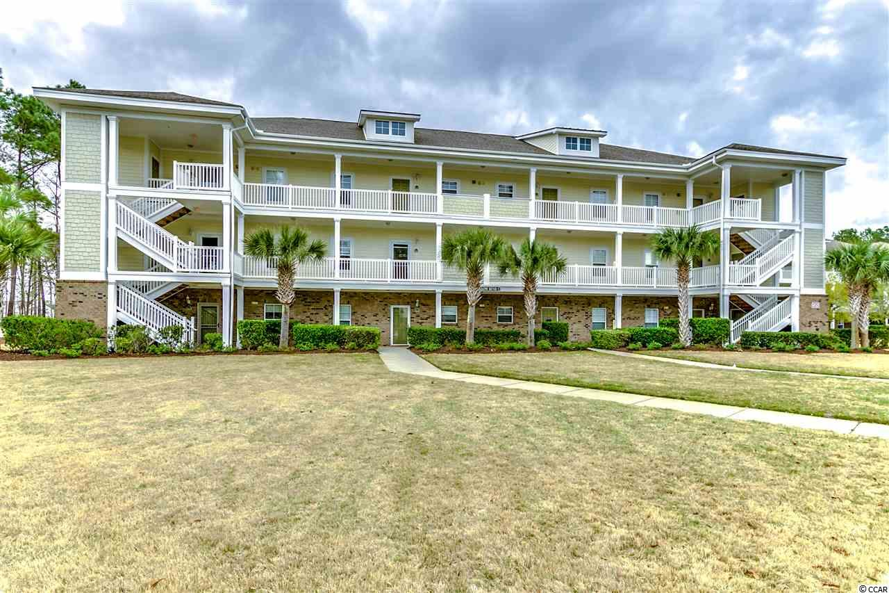 Two (2) Bedroom, Two (2) Bathroom, Top-floor Golf Villa boasts amazing views of Greg Norman Golf Course in Barefoot Resort & Golf, a world-class 2,300 Acre master-planned resort of the highest caliber. Excellent second home and investment property! The Villa is approximately five (5) minutes from to the beach by car. Amenities for owners include 4 championship golf courses, two main clubhouses, illuminated driving range and golf school, oceanfront beach cabana, 15,000 sq ft salt-treated swimming pool, a deep water marina and miles and miles of biking and walking trails. Located within 1 1/2 miles of the Atlantic Ocean and just over the bridge from Award-winning Barefoot Landing Festival center, Barefoot Resort & Golf is truly that exceptional place that once you visit you will want to own your piece of paradise!