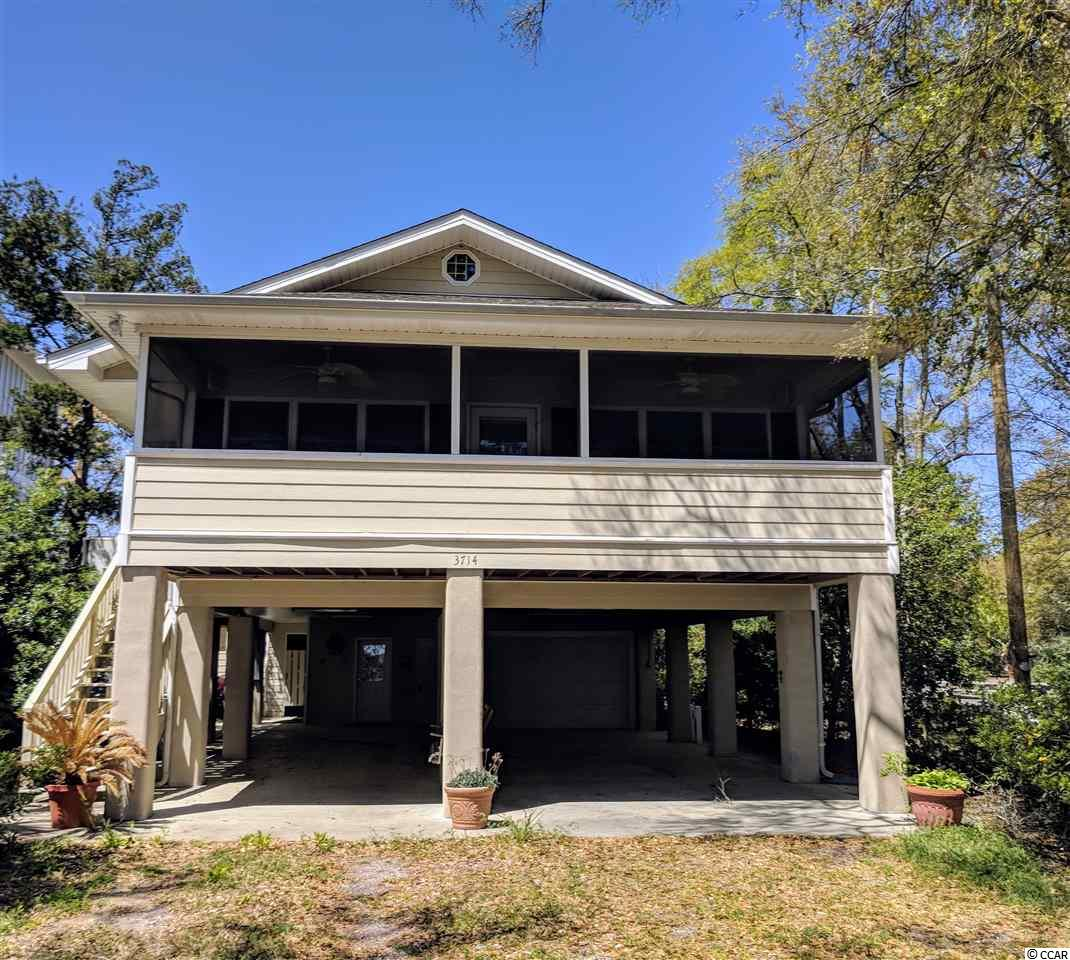 This home is located on the channel with exterior amenities including: aluminum floating dock and walk, boat lift, ocean access at high tide, an outside shower and sink for scaling fish and other seafood prep. There is parking underneath for four or five cars and/or boat. Pool and hot tub are covered and screened. Conveniently located near the Murrells Inlet marsh walk and restaurants, Garden City beach ,Huntington Beach State Park and Brookgreen Gardens. One-car garage including a half bath. Additional interior features include a Carolina room with 11.5' x 27' dimensions and an enormous screened porch.