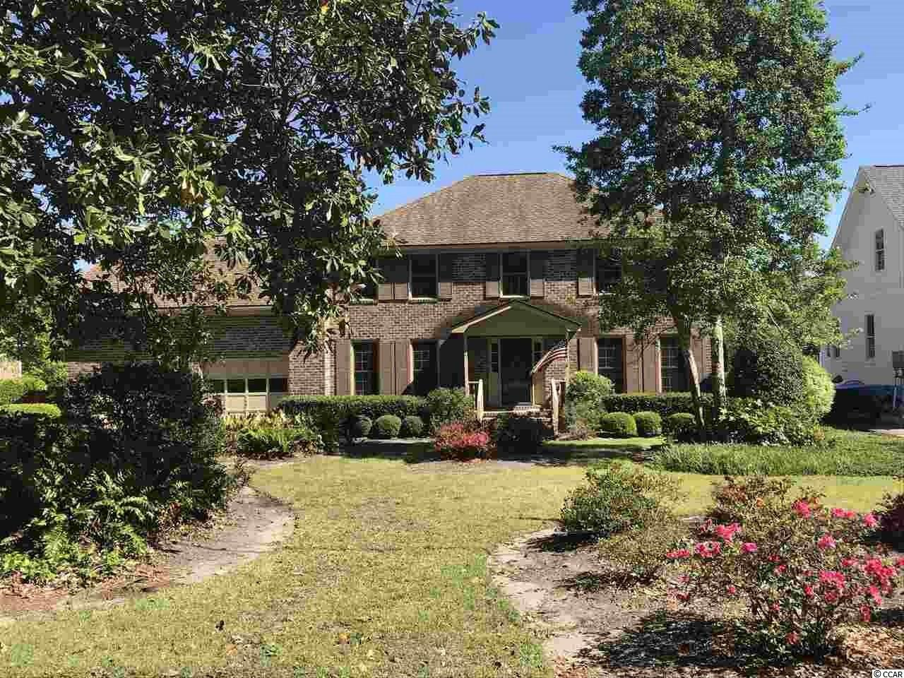 594 Rum Gully Road is a 4-bedroom, 2-1/2 bath home located in the sought-after Mt. Gilead neighborhood. This home features a private pool along with a covered and floating dock. The interior layout is a classic and desirable design. Formal living room, dining room, kitchen (with breakfast area) and den located on the first floor with all four bedrooms on the second floor. A half-bath accompanies the living areas on the first floor with both full bathrooms upstairs with the bedrooms. There is also a bonus room above the garage which is accessed from a separate set of stairs off the kitchen. A screened in porch located off the den overlooks the pool area. If you've been waiting on a traditional style home on the water in Mt. Gilead to hit the market, you're wait is over. Contact the listing agent, or your Realtor, to arrange a private showing.