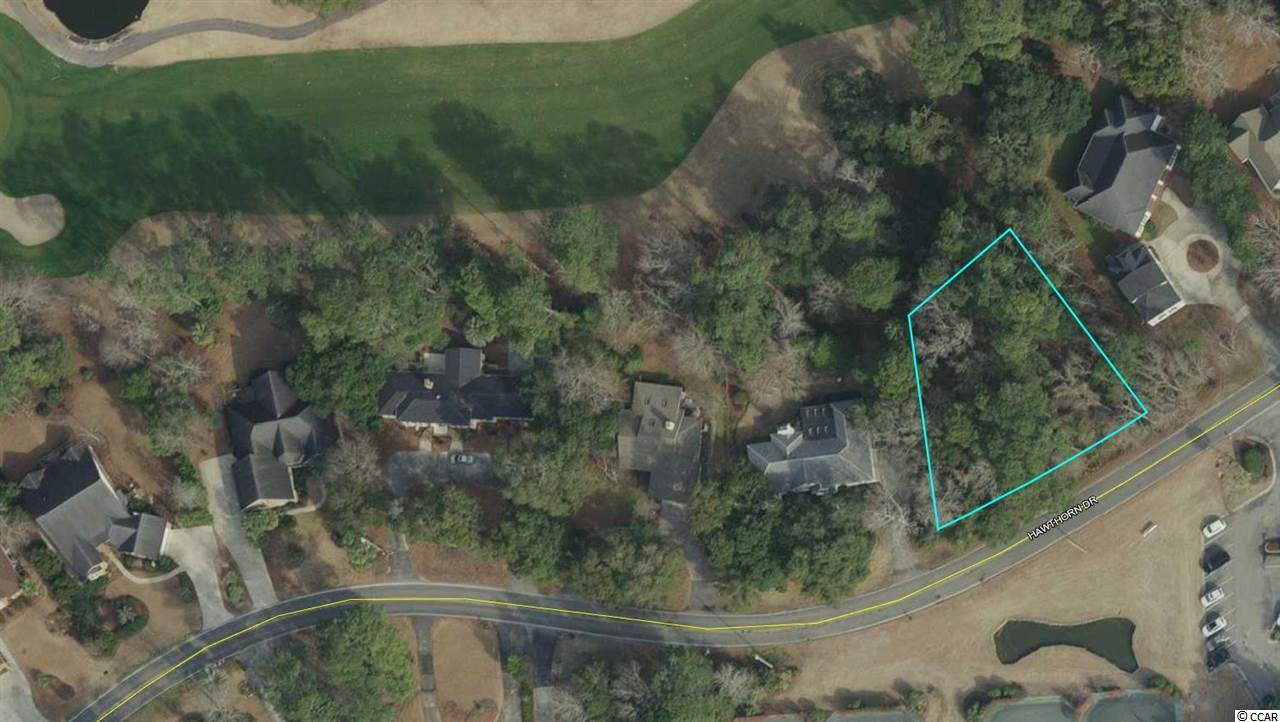 Wooded lot in established community of Litchfield Country Club. Overlooks the beautiful 8th fairway. Litchfield Racquet Club Tennis Courts are directly across the road. Memberships are required for use of community golf and tennis. Active voluntary HOA with restrictions. Enjoy easy convenience to the beach by bicycle or golf cart! Also convenient to great local dining and shops. Public boat launches to the Waccamaw River nearby.