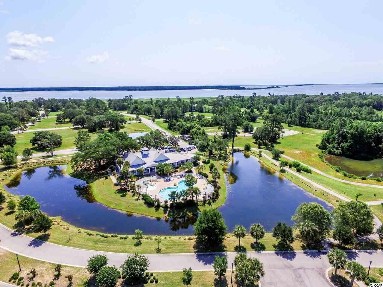 Located in South Island Plantation, a gated community located along Winyah Bay and the Intracoastal Waterway, near Historic Georgetown, SC. Community amenities include a pool, kiddie pool and hot tub. There is also a 5000 sq ft club house with an equipped fitness center, a bar and a full kitchen. Walking trails wind throughout the community with gazebos for periodic resting.  A fishing/crabbin' gazebo is  now complete. A secured RV/ Boat storage area is available for property owners. Beautiful ponds for fishing and huge Oak Trees make this one of the premier communities in the Georgetown area. Natural gas is also available in South Island Plantation. Build your dream home today....