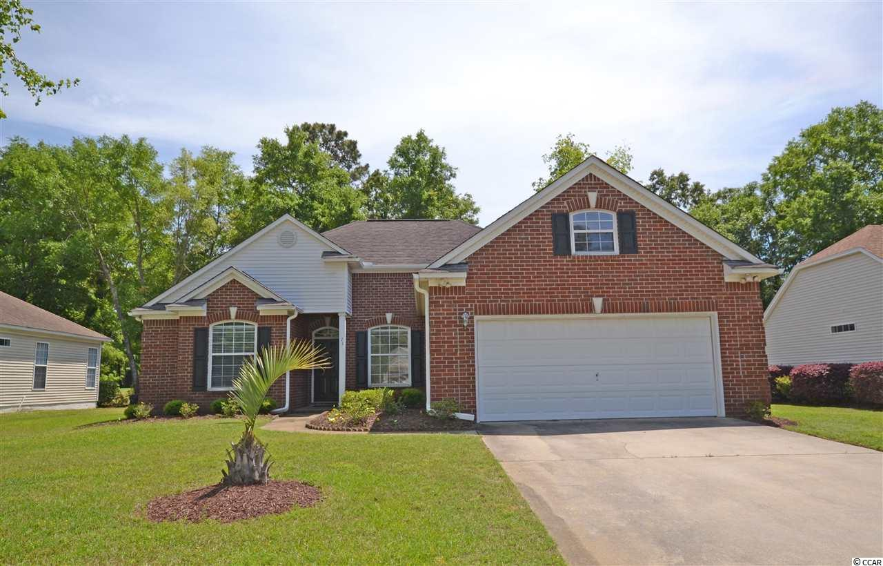 Great brick home in on golf course in desirable Tradition Club. 3BR/2BA on a quiet cul-de-sac and close to local public and private schools. Tiled living room with fireplace opening up to the Carolina Room. Kick back and relax on the back patio with views of the golf course. The master suite features a large bedroom with tray ceilings, double sinks, tub and shower. NEW ROOF added November 2018!!! Tradition is a golf course community with a pool, clubhouse and private beach access through Litchfield by the Sea. Pawleys Island/Litchfield Beach is located just 70 miles from historic Charleston and 25 miles from the attractions of Myrtle Beach. Fine dining, shopping, and more just moments from your doorstep in Murrells Inlet and Pawleys Island. Don't miss this one!