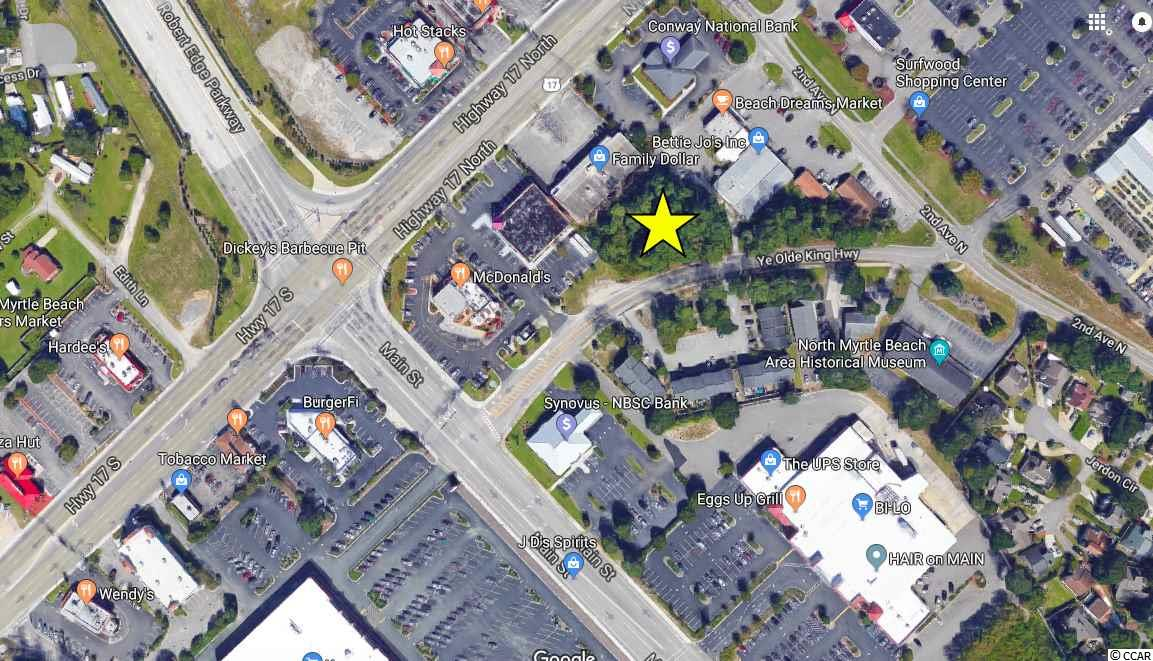 Commercial lot located just one block off Main St. in the heart of North Myrtle Beach in the Ocean Drive section.  Property is approx 0.60 acres and is zoned HC by the City of NMB.  This is in a prime location and is situated behind McDonalds restaurant and the Family Dollar store on Ye Old Kings Hwy.  This zoning allows for a vast array of commercial uses. Fantastic location for this commercial lot on old Ye Olde Kings Hwy very close to Main St. and backing up to Family Dollar.  This large tract of commercial property is approx. 6/10 of an acre and boasts a prime Ocean Drive location just one block off Hwy 17 and steps to Main St.  Road frontage is approx. 218 ft.  Total dimensions as per CRS data are 218' x 98' x 187' x 203'.