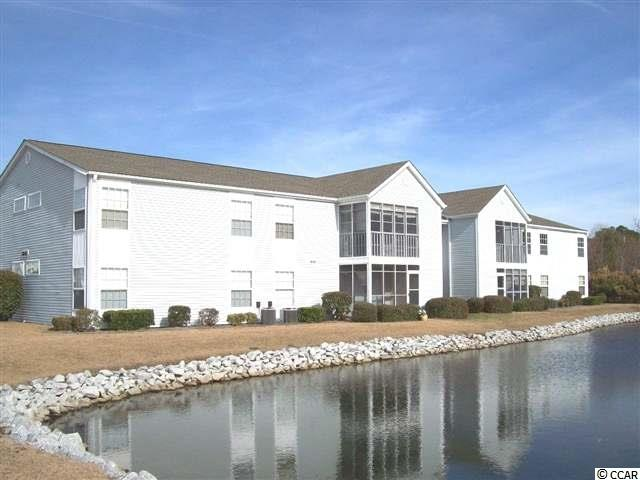 PRICE REDUCED!! FANTASTIC OPPORTUNITY TO OWN THIS ABSOLUTELY BEAUTIFUL SECOND FLOOR CONDOMINIUM IN GREAT SURFSIDE BEACH LOCATION. NEW REFRIGERATOR (2016), RANGE (2016) AND CARPET (2016). ALL APPLIANCES CONVEY - MOVE RIGHT IN. SCREENED PORCH WITH STORAGE CLOSET OVERLOOKING LAKE. LOCATED CLOSE TO THE BEACH, SHOPPING, RESTAURANTS AND ENTERTAINMENT. SEE TODAY!!