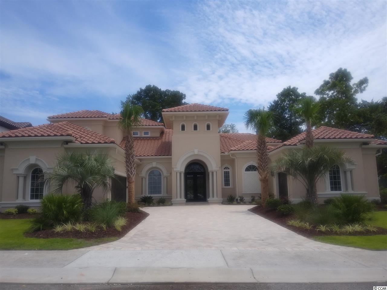This custom home is being built in Villa Venezia and is under contract.  Please feel free to view the home while under construction or visit our Villa Venezia Model Home next door.  Our Venezia Model Home is open 7 days a week.  This particular homesite will overlook the Intracoastal Waterway while located on the Resort Golf Course in Grande Dunes.  Other similiar homesites are available.