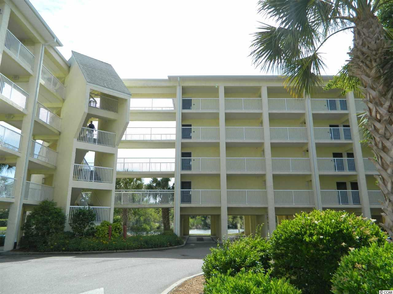 Enjoy the beautiful serene lake view from your 4th floor, open end balcony in this Summerhouse condo! Great opportunity for a vacation retreat or investment property with rentals.The recently updated interior of this 1 bedroom, 1 full tiled bath condo is beautifully decorated. It has a fully equipped kitchen with granite countertops, full size refrigerator, living room with tray ceiling, crown molding, full sleeper sofa and bedroom with 2 queen beds. Elevator and laundry facilities on site.Amenities include a large outdoor pool with lazy river, hot tub/spa and children's area adjacent to building. Walk or take the complimentary shuttle to private beach access at Litchfield by the Sea with restrooms and large decks. Resort amenities include tennis court, walking/biking trails, fishing and crabbing docks, kayak launch area. Shopping, dining and golf nearby. Building totally renovated in 2008. New HVAC installed in 2014.