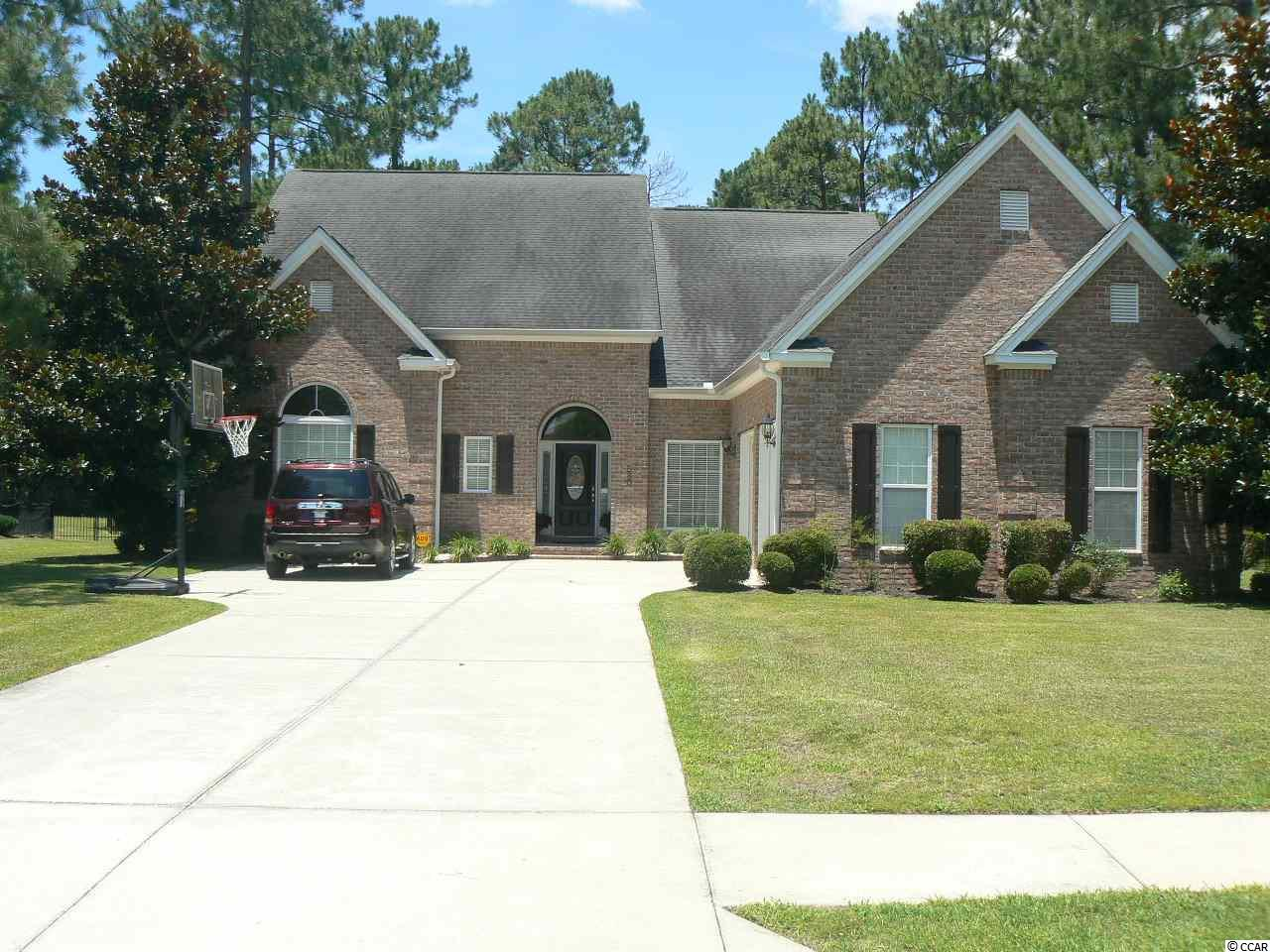 Here is your opportunity to own an incredible, all brick home in one of the most sought after neighborhoods in Myrtle Beach. This impressive home features a spacious split floor plan that is filled with natural light, formal dining, spa-like master bath, and large master bedroom that opens directly to a private screen porch that backs up to the peaceful seclusion of nature. Upstairs features a large bonus room already equipped with projector and media screen for fun-filled movie/game nights. The large bonus room also opens to the upstairs balcony overlooking the peaceful back yard and beautiful pergola and outdoor living space equipped with a grill and patio furniture. The spacious upstairs also features 3 large bedrooms and a full bath. One of the large upstairs bedrooms has direct access to the upstairs balcony as well as an additional room ideal for a nursery or office. Interior of the home has just been completed repainted and is ready for your personal touches. Plantation Lakes is located within mere minutes of all that Myrtle  Beach has to offer but feels miles away from the hustle and bustle. Incredible schools, new medical facilities, impressive community pool and amenity center, fine dining, major highways, airport, and of course the beautiful beach are all within 15 minutes drive time. Quiet streets and a peaceful neighborhood great for a leisurely stroll or exercise.   Make this home a must see!