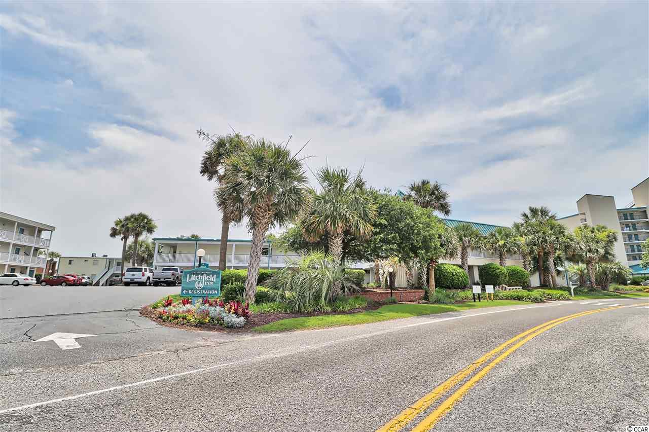 This second-floor Litchfield Inn unit has spectacular views of the ocean and is only steps from the beach and the pool. Looking out over the beachfront pool deck, this condo has been upgraded with granite countertops in the kitchenette area and the bathroom. The Litchfield Inn provides a lifestyle like no other in the area. Cabana Café is open for relaxed and casual drinks and food while Oceans One provides exquisite dining with an oceanfront view. Two pools and miles of sandy beaches provide the total lifestyle that is found only at the Litchfield Inn. All measurements are approximate and Buyer is responsible for verification. Wonderful rental opportunity.