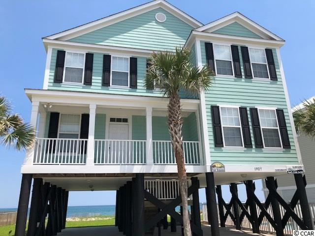 Furnished 5 BD / 5 BA raised beach home, just outside of the Inlet Pointe subdivision gate, that can sleep 14 with 2 oceanfront master suites,   additional sitting area, tiled main floor, pool, oceanfront covered porches overlooking over 80' of the Atlantic Ocean, covered front porches, private walkway to beach & outdoor shower.