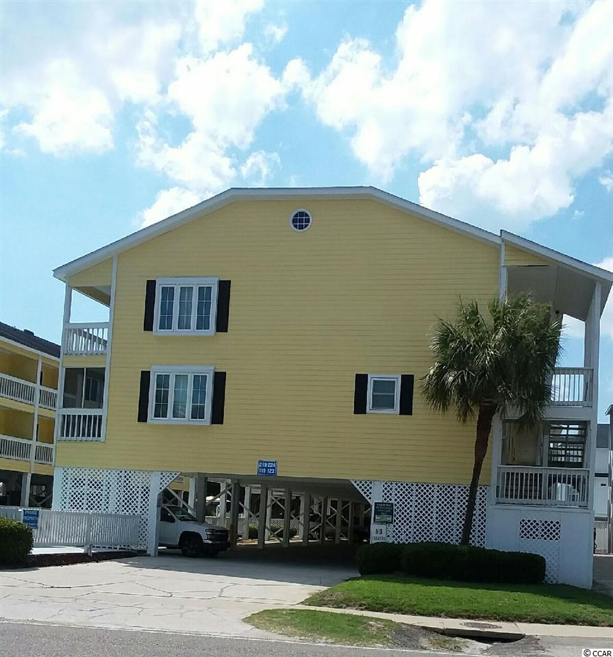 Best unit in Sandy Shores III. Closet unit to beach second floor with lots of natural light and completely repainted and all furnishings stay!! Outdoor pool and two minute walk to beach...A must see...New slider to deck, golf carts allowed