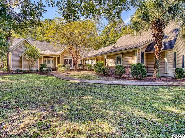222 Old Carriage Loop provides a wonderful opportunity for all one level living in a lovely, natural setting in a great DeBordieu neighborhood.  Brand new roof as of September, 2018 and other improvements are being made!  Enjoy a larger lot (almost 1 acre) that backs up to part of the 800 acres in DeBordieu that will never be developed.  Wildlife abounds in the privacy of your own back yard and can be seen while sitting on the screened in back porch with a vaulted ceiling.  Inside this very well maintained home there is a beautiful formal living and dining area as well as a large Great Room with vaulted ceilings, plenty of natural light and a wood-burning fireplace.  The Master Suite is conveniently located on the opposite side of the house from the guest bedrooms and includes a gas fireplace and nice walk-in closet.   If you're looking for simple living in a quiet, private setting - this one is for you!