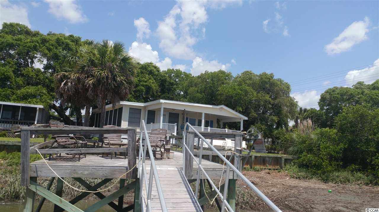 "A rarity...waterfront living in the heart of Garden City Beach. Enjoy the inlet breezes from the huge porch overlooking the marsh. Stationary dock with floating dock. Nestled under the large oaks this charming bungalow has just underwent a reno. Newly remodeled kitchen with vinyl plank flooring. Freshly painted interior...Spacious master suite with garden tub an separate shower. The Inlet Room boasts expansive views with all windows..and enough space for family hang outs/dining. Come taste the ""Inlet Life""."