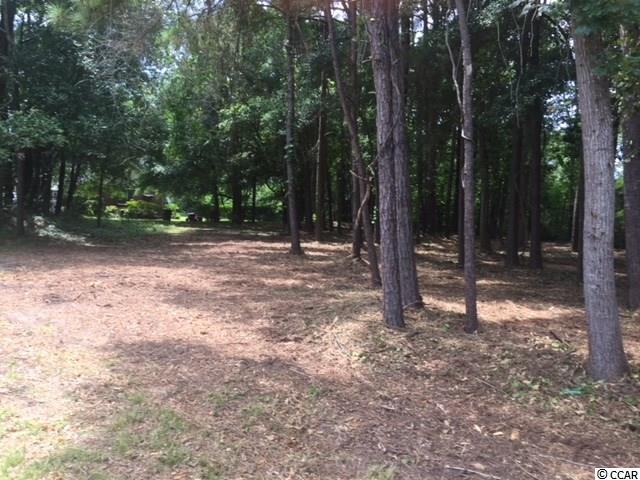 This is a beautiful rectangular estate size lot east of Hwy 17 on Golfview Dr. in very desirable Tilghman Estates.  This premier location will live up to your expectations of a mature, serene location and wonderful proximity for walking or short golf cart ride to beach, restaurants, abundant shopping and much more! Build your dream home and create your own private world on this .53 acre lot.
