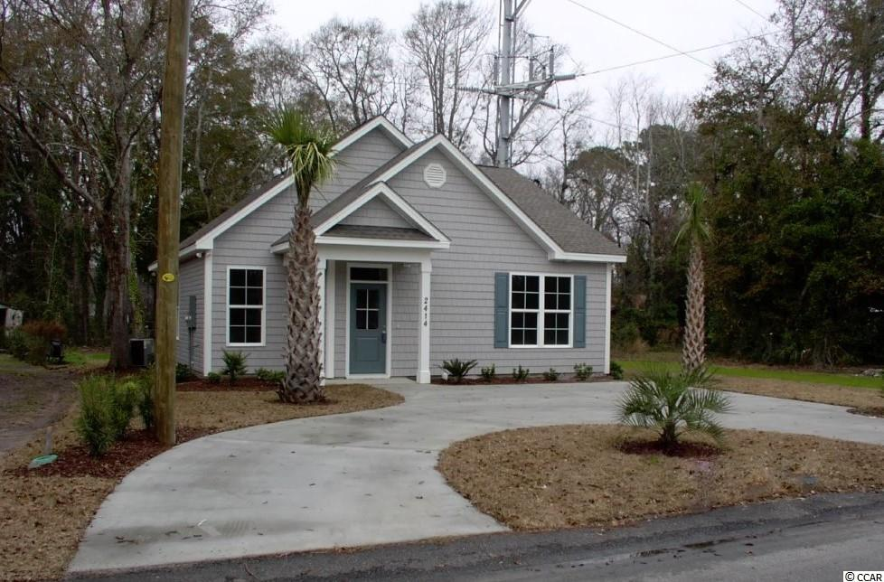 Move-in Ready home located in the heart of North Myrtle Beach. Will be a great primary home or second home that is a short walk or golf cart ride to the beach. No HOA fees or property restrictions. Home has stainless steel appliances, laminated wood floors thought the home and white granite counter tops throughout the home as well. Wonderful 2 bedroom/2 bath home, ready for you to move in. Square footage is approximate and not guaranteed. Buyer is responsible for verification.