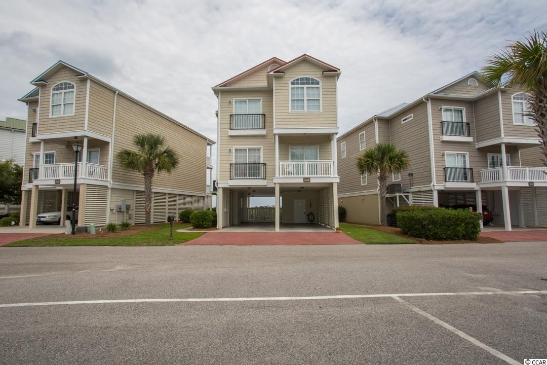 Enjoy spectacular marsh views from this 5 bedroom 4 bath raised beach home located in the Cherry Grove section of North Myrtle Beach.  Only 18 unit in development.  This home offeres multiple balconies and a private pool all overlooking the marsh.  The kitchen features granite countertops and stainless steel appliances.  There is a laundry room with washer/dryer.  There is hardwood flooring throughout and 9' ceilings with crown molding.  Plenty of stoarage for all your beach items.  Just a short golf cart ride to the beach.  Conveniently located to golf, shopping, entertainment, and al;l area attractions.