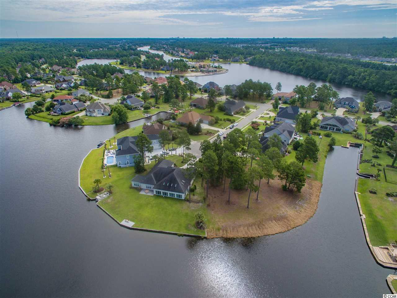 Beautiful LAKEFRONT lot in sought after Plantation Lakes! YOUR DREAM...Can be a reality! This lot features over 200' of beautiful shoreline, is located at the end of a quiet cul de sac and is ready for you to build on! Size is approximately .84 acres, making it one of the largest lots available. This exquisite  community is like no other.  Beautiful custom homes backing up to miles of intertwined shoreline- perfect for your pontoon boating pleasure!  The community offers over 15 miles of lake and top notch amenities including 2 Swimming Pools  connected with a waterfall, Club House with Fitness Center, Tennis, Day Docks, Horseshoe Pits, Play Grounds and more!  Awesome location in Carolina Forest and close to beaches, pools and shopping! There are very few lots left in this community so don't let this opportunity pass you by. All measurements are approximate and buyers are responsible to verify any information that pertains to them making a decision. Owner/Seller licensed Maryland Agent
