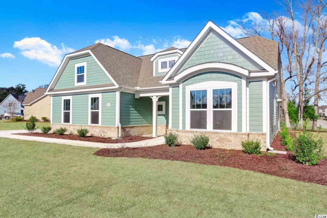 "Move-in-Ready in 2018! This popular Wrightsville home plan, with a Side Load Garage, sits on a large corner home site, on a beautiful Cypress Pond, in the popular Shaftesbury Estates neighborhood. Enjoy the view from either the Bay window area in the Dining nook or the Master bedroom. This home has a Study with French Doors, as well as a large Rec Room, in addition to the included 3 bedrooms. Buyers will also love the All-tile shower in the Master Bath. 5"" Laminate floors will cover the main living areas, including the Study, and all Baths and Laundry will have Tile flooring. (Bedrooms and Rec Room are carpeted). The beautiful Kitchen is a must-see with a Level 3 Granite countertop and Subway tile Backsplash. The Covered Front and Rear porches are the perfect outdoor space to entertain or simply relax. Stop by today and see this gorgeous home! Don't forget, homeowners can enjoy Free Greens Fees for Life at Shaftesbury Glen Golf Course!"