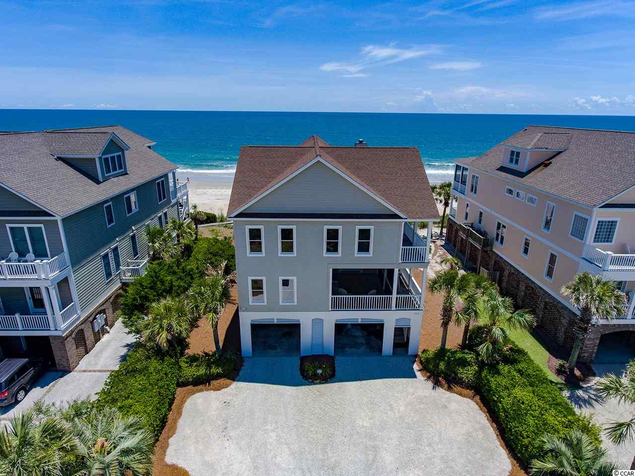 This timeless oceanfront home is being offered fully furnished and is ready for you and your family to live your best, beach life. There are several large porches with direct ocean views. Simplicity in form and function is just what you need at the beach. There are 5 bedrooms and 5 full baths. The open kitchen, dining area and great room are on the top floor providing inviting views in your main living areas. An elevator gives easy access to all floors. Washer and dryers on both levels, plenty of storage for you beach toys, steps to the beach, and a small den on the first level make it a great family home. Enjoy the Pawleys Island and Litchfield coastal heritage with your family. Inlet Point South is a wonderful gated community in South Litchfield with a boat landing and pool offering fun for all. Call to learn about his home's rental income and much more.
