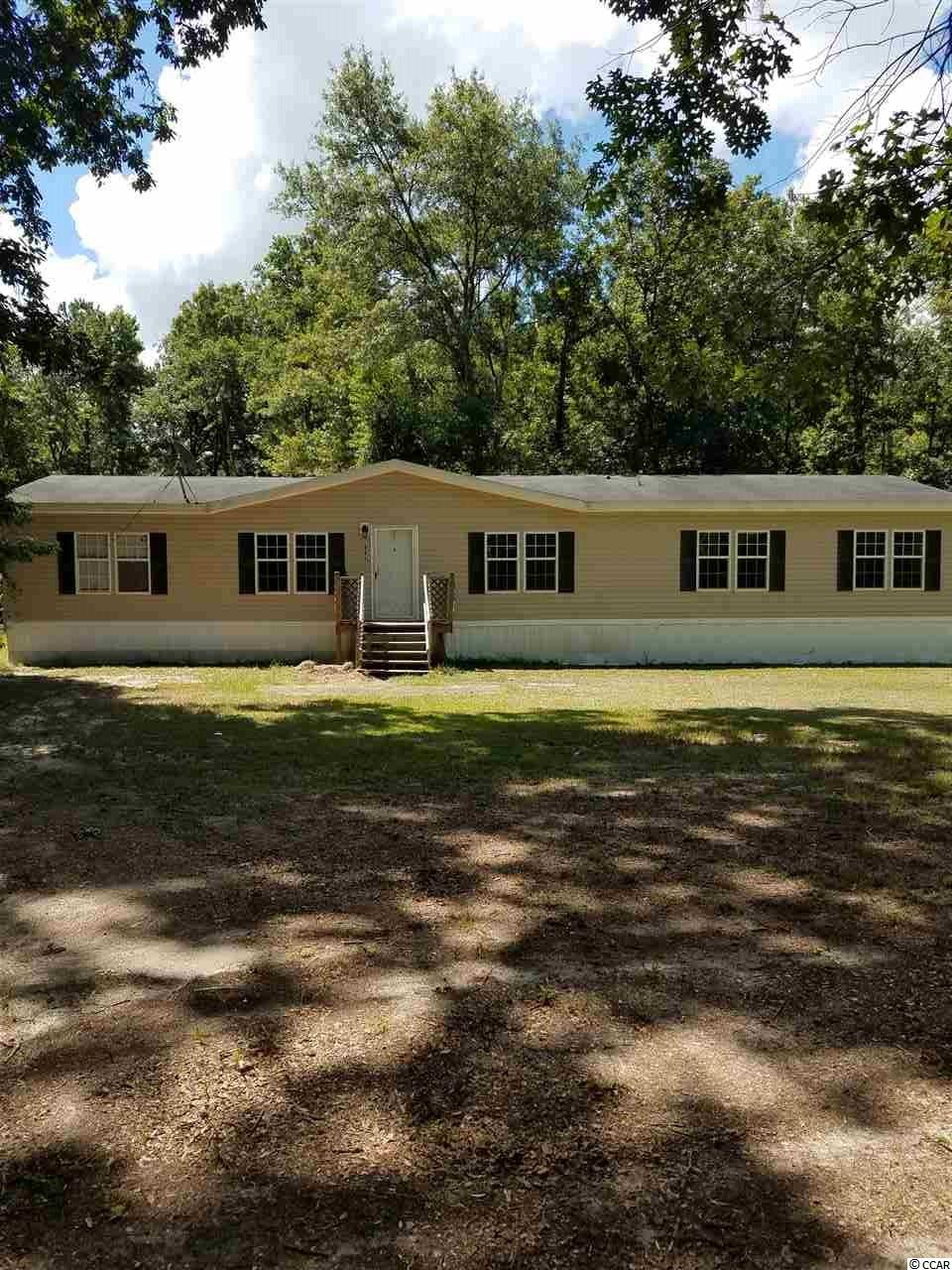 Enough room for the whole family and NO HOA!!!! Come check out this spacious 5 bedroom 3 bath home. This home offers a master bedroom with a garden tub and separate shower, a jack and jill bedroom, an open kitchen, dining room, a huge living and family room!!! It comes on 1 acre of land and is walking distance to the Waccamaw National Wildlife Refuge and the Pee Dee River. This home did not flood or get damaged during or after the Hurricane either!