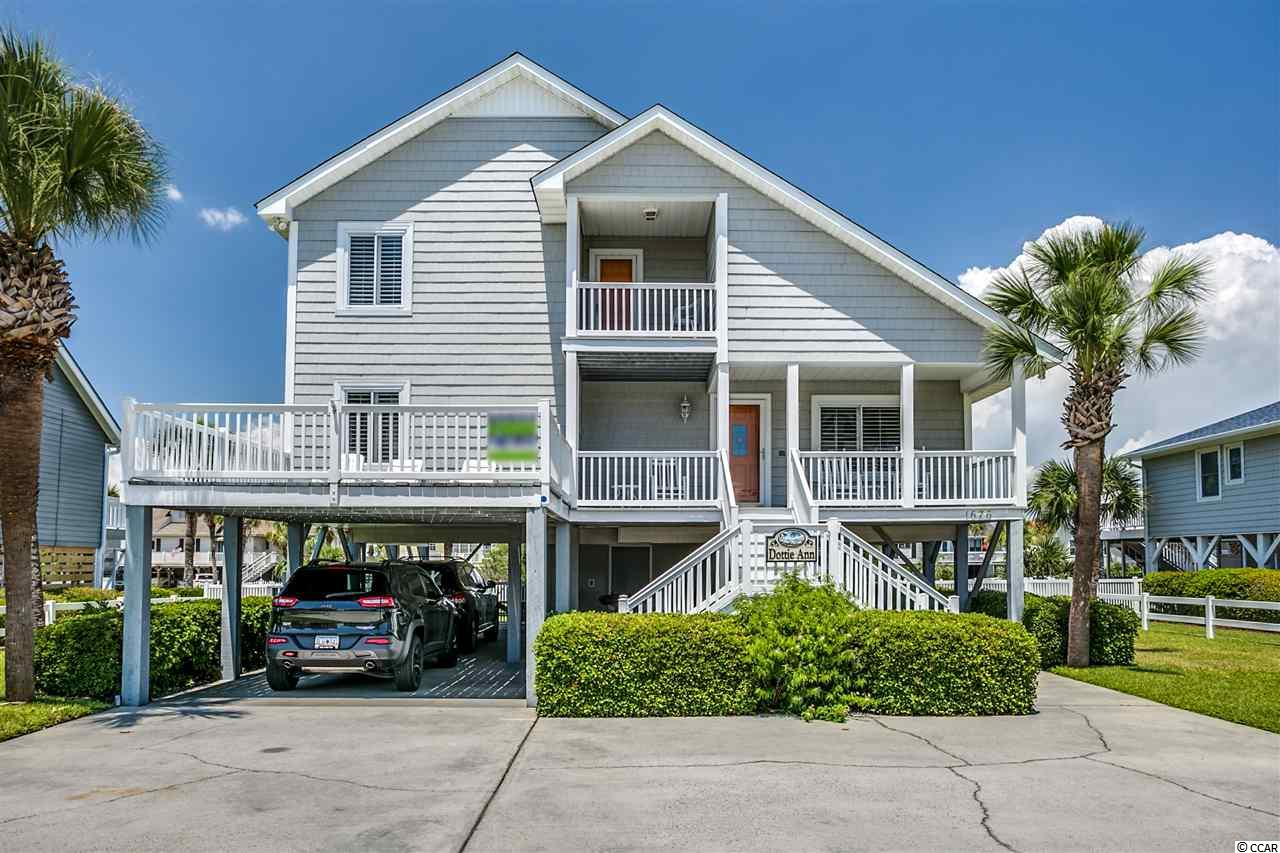 Closing scheduled for 10/4/19. Situated on a large, second-row lot, 1676 South Waccamaw Drive is an ocean view, single family raised beach home around 2.4 miles south of the Garden City Pier and the small downtown restaurant district. The house has five bedrooms and three bathrooms with approximately 2213 heated square feet. The exterior of the home offers low maintenance vinyl shake siding and vinyl railings. There is an oceanside covered porch, sundeck, and balcony affording gorgeous sunrises and ocean views. On the poolside of the house, there is a vast sundeck and paver pool deck where you'll see stunning sunsets over Murrells Inlet. The oversized private walk-in heated pool features a wading area for the kids or lounging in the water. The large backyard has a vinyl picket fence, irrigation system with well, and a built-in charcoal grill. Under the home, there is a large attached storage room with second door large enough for a golf cart, enclosed shower/dressing area, built-in gas grill and covered parking. There is also sufficient parking out front for boats and cars. The roof was replaced in 2018, and the HVAC system is only three years old. The fully furnished interior features an open living area with laminate wood floors on the main level with access to the Carolina room and includes a large kitchen, full bathroom, and two bedrooms. Upstairs there are three more bedrooms and two full bathrooms. The home is currently on a vacation rental program and has a thriving income history available upon request. Located across the street from one of the quietest, most beautiful, and most extensive beaches along the Grand Strand. The beach access is only two houses south. Why rent when you can own your very own beach retreat.