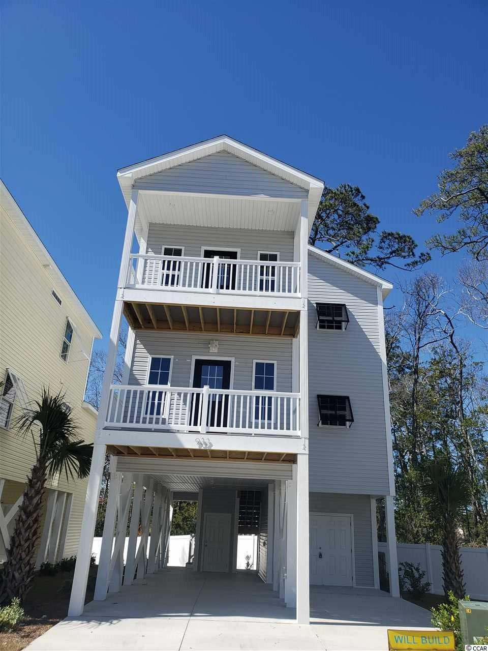 3BR / 2.5 BA / 1550 HSF raised beach home east of Hwy 17 in NMB. New construction home that features: 9' ceilings, custom kitchen with granite countertops and stainless appliance package, crown molding, master bath features tiled shower, wood floors throughout less baths, front porches, golf cart storage and parking under home, full landscape package with irrigation and concrete driveway.