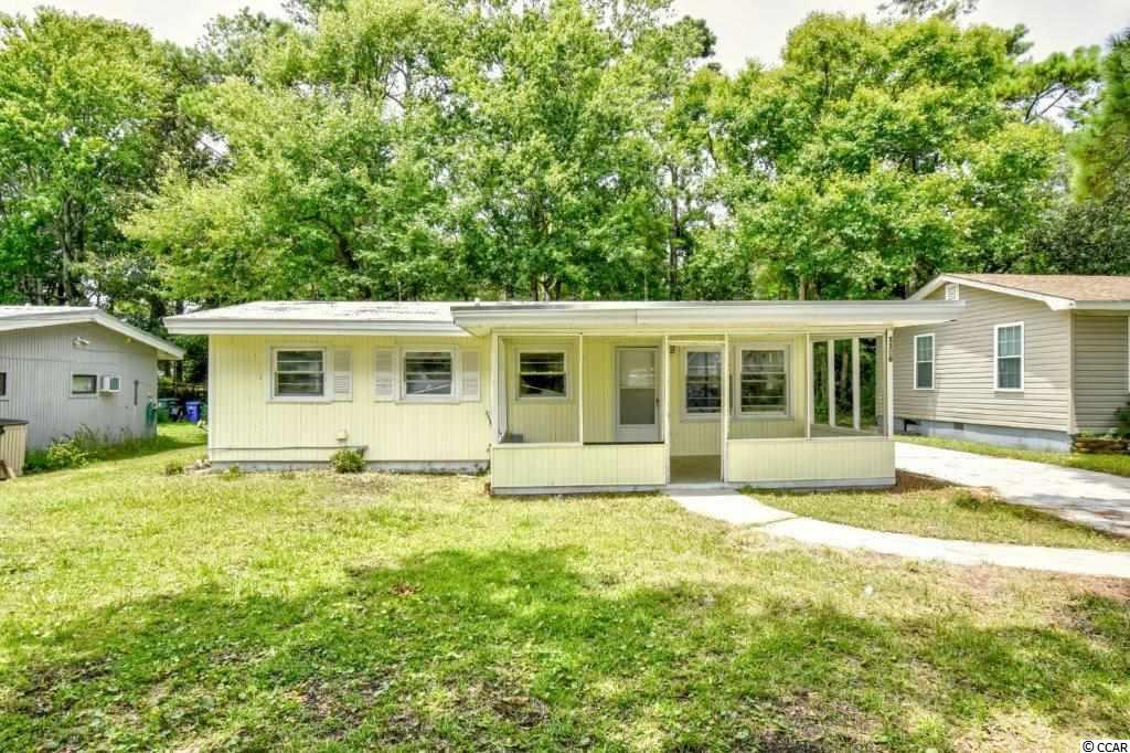 2 Bedroom 1 bath home close enough to the beach to hear the waves. A blank canvas to make your own. Sit back relax and enjoy your morning coffee or the evening breeze on the spacious front porch. With a little TLC can be a great rental investment or vacation home close to all the area has to offer!