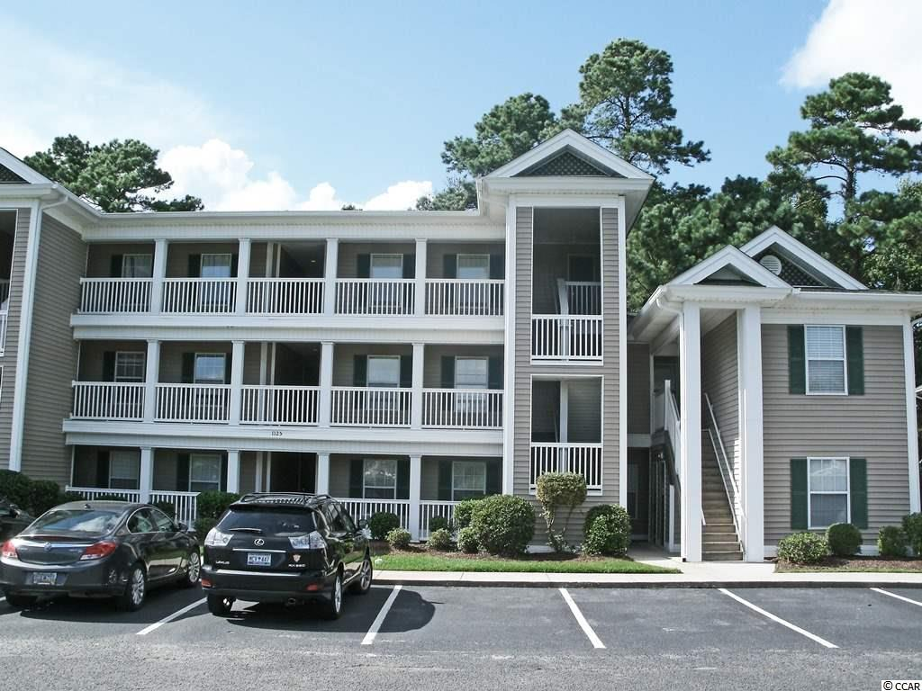 Bring your own decorating touch to this unfurnished, three-bedroom, two-bath condo in the golf community of True Blue in Pawleys Island. New flooring and fresh paint throughout! This second-story condo offers not only a peaceful wooded back drop, but also some lovely lake views from the guest rooms. Amenities include community pool and tennis courts. Convenient to shopping, great restaurants and the beach.