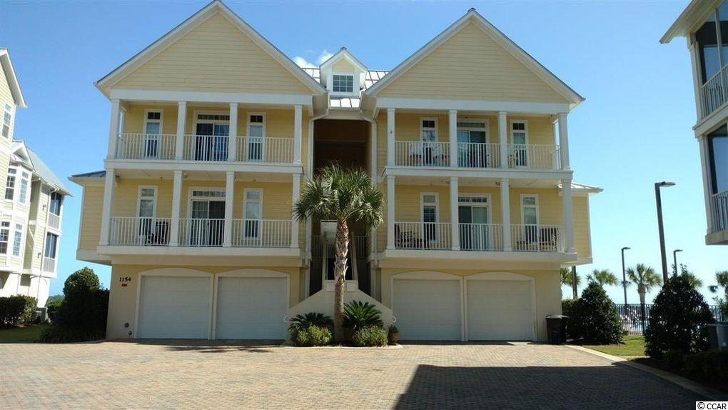 Great 3 bedroom raised condo in beautiful Belle Isle Yacht Club. Enjoy the sunrise over Winyah Bay and sunsets over the lake in this private gated community. Watch the boats travel up and down the Intracoastal Waterway from your screened in porch. 3 bedroom 2 bath unit all on one floor. On suite bathroom for master bedroom with walk-in closet. Huge garage with separate storage area. Amenities included  private gated beach house on Pawleys Island, 2 pools, tennis courts, marina with marina grill and yacht club. Minutes from historic downtown Georgetown and just a short drive to Myrtle Beach and Charleston. Almost new golf cart available with right offer