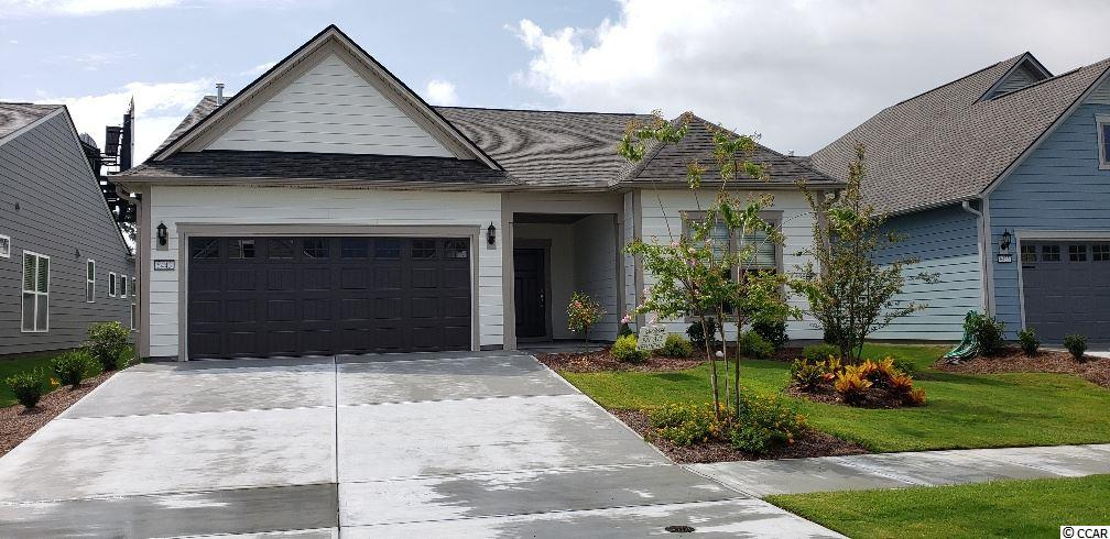 This is a proposed to-be built home, photos and decorated interior are of a model home. Actual home will vary. Abbeyville floor plan: Popular Open floorplan with FIREPLACE! Dream gourmet kitchen with built in stainless Whirlpool appliance package and 5 burner natural gas cooktop. Granite countertops through out, large tiled master shower with tiled bench. Large screen porch and patio, crowne molding package and large walk in master closet. Hardwood flooring in foyer, kitchen and breakfast/dining area. Tile flooring master bath 55+ Community along the Intracoastal Waterway with onsite Lifestyle Center including indoor/outdoor pool, fitness center, tennis, pickle ball, bocce, and full time lifestyle director. Also includes a private oceanfront beach club amenity within Grande Dunes. Exterior Elevation LC1A.