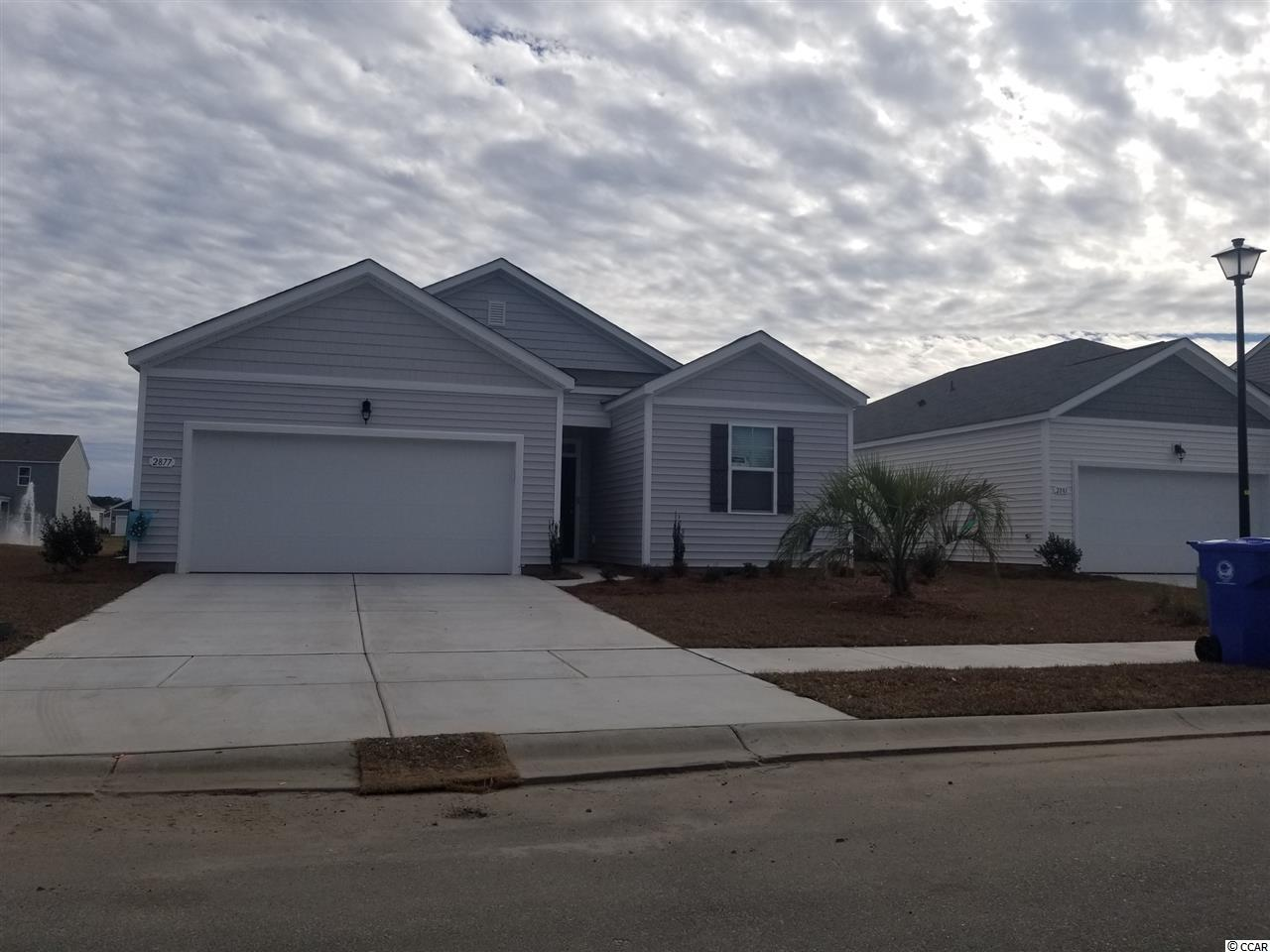 This adorable open-concept 1-level plan will be completed SEPTEMBER 2018! Enjoy a large family room, private owner's suite, and 2-car garage. Kitchen features Espresso staggered cabinets with crown molding, granite counter tops, stainless steel appliances. Beautiful solid surface wood look floors through out the home with carpet in the bedroom. Be the first to live in Meridian at Market Common. The Meridian will offer 200-300 new homes, featuring 10 floor plans both ranch and two story homes. We are the price-leader for single family homes in Market Common! Our home owners will enjoy a gracious pool, open air amenity center, pickle ball court, walking trails and a short golf cart ride to the beach. Live like you're on vacation! Photos of home are of a model home of same floor plan in another community and are for presentation only.